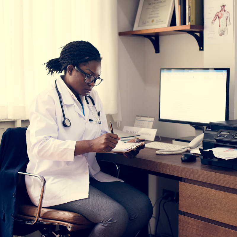 Female healthcare working at desk